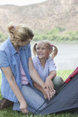 Mother And Daughter Pitch A Tent — Stockfoto