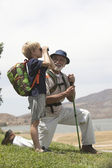 Grandfather And Grandson Bird Watching — Stock Photo