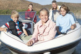 Caucasian Family Of Five In Speedboat — Stock Photo