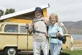 Senior Couple With Walking Poles And Campervan — Stock Photo