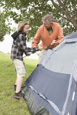 Father And Son Pitch A Tent — ストック写真