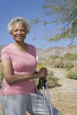 Mature Woman With Walking Poles — Stock Photo