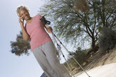Woman With Walking Poles Using Cell Phone — Stock Photo