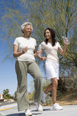 Mother And Daughter Jogging Together — Stock Photo