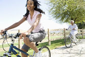 Mother And Daughter Race Mountain Bikes — Stock Photo