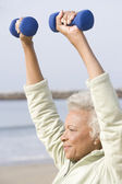 Senior Woman Exercising With Dumbbells — Stock Photo