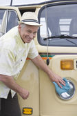 Senior Man Polishes Headlights On His Campervan — Stock Photo