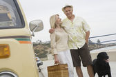 Senior Couple On Beach Promenade With Campervan — Stock Photo