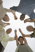 Multiethnic Holding Hands In A Huddle — Stockfoto