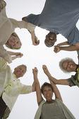 Multiethnischen holding hände in ein wirrwarr — Stockfoto