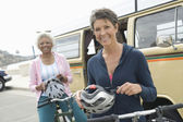 Senior Female Friends Holding Cycling Helmets — Stock Photo