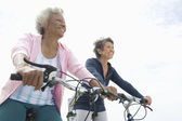Senior Female Friends Riding Bicycles — Stock Photo