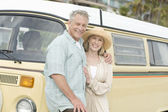 Couple Standing Together Against Campervan — Stock Photo