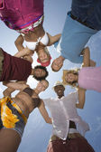 Multiethnic Friends Forming Huddle — Stock Photo
