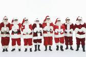 Skupina mužů oblečený v santa claus oblečení — Stock fotografie