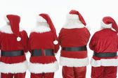 Rear View Of Four Men Dressed In Santa Claus Outfits — Stock Photo