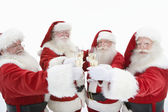 Group Of Men In Santa Claus Outfits Toasting Flutes Of Champagne — Stock Photo