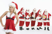 Group Of Men Dressed As Santa Claus Standing With Mrs. Claus In Foreground — Foto Stock