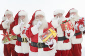 Group Of Men Dressed As Santa Claus Holding Gifts — Stok fotoğraf
