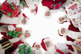 Men In Santa Claus Outfits Forming Huddle — Stock Photo