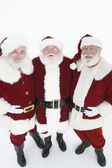 Happy Men In Santa Claus Outfits Standing Together — Stock Photo