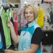 Woman Shopping For Sports Clothing In Shop — Stock Photo