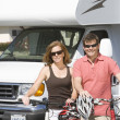 Couple With Bicycles Against RV — Stock Photo