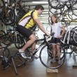 Couple Buying Bicycle At Shop — Stock Photo #21927921