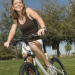 Woman With Bicycle In Park — Stock Photo #21927971