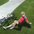 Female Cyclist With Bicycle Relaxing In Park — Stock Photo