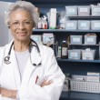 Confident Female Doctor With Hands Folded In Clinic — Stock Photo