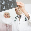 Doctor Explaining X-Ray To Patient — Stock Photo