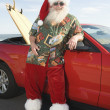 Father Christmas By Convertible With Surfboard — Stock Photo