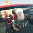 Father Christmas In Convertible With Surfboard — Stock Photo