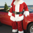 Father Christmas By Convertible With Christmas Tree — Stock Photo #21928651