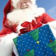 Santa Claus Giving A Present — Stock Photo