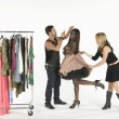 Fashion Model With Artists Adjusting Her Outfit — Stock Photo