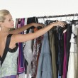 Model Selecting Dress — Stock Photo