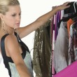 Model Choosing Dress — Stock Photo