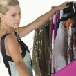 Stock Photo: Model Choosing Dress