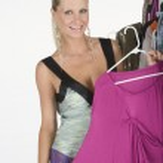 Fashion Model Holding A Pink Dress — Stock Photo
