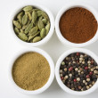 Different Types Of Spices Arranged In Bowls - Stock Photo