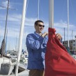 Man Securing Sail Of Boat — Stock Photo
