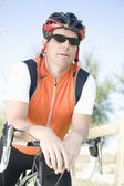 Male cyclist leaning on handlebars — Stock Photo