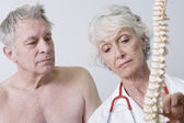 Doctor Explaining The Problems About Spinal Cord To Patient — Stock Photo
