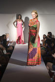 Woman In Multicoloured Dress On Fashion Catwalk — Stock Photo