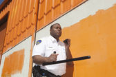 Security Guard With Baton Using Walkie Talkie — Stock Photo