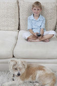Boy Watching TV With Dog — Stock Photo