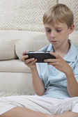 Boy Playing Games On PSP — Stock Photo
