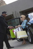 Chauffeur Helping Woman With Shopping Bags — Stock Photo